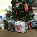 Blankets and pillows under christmas tree